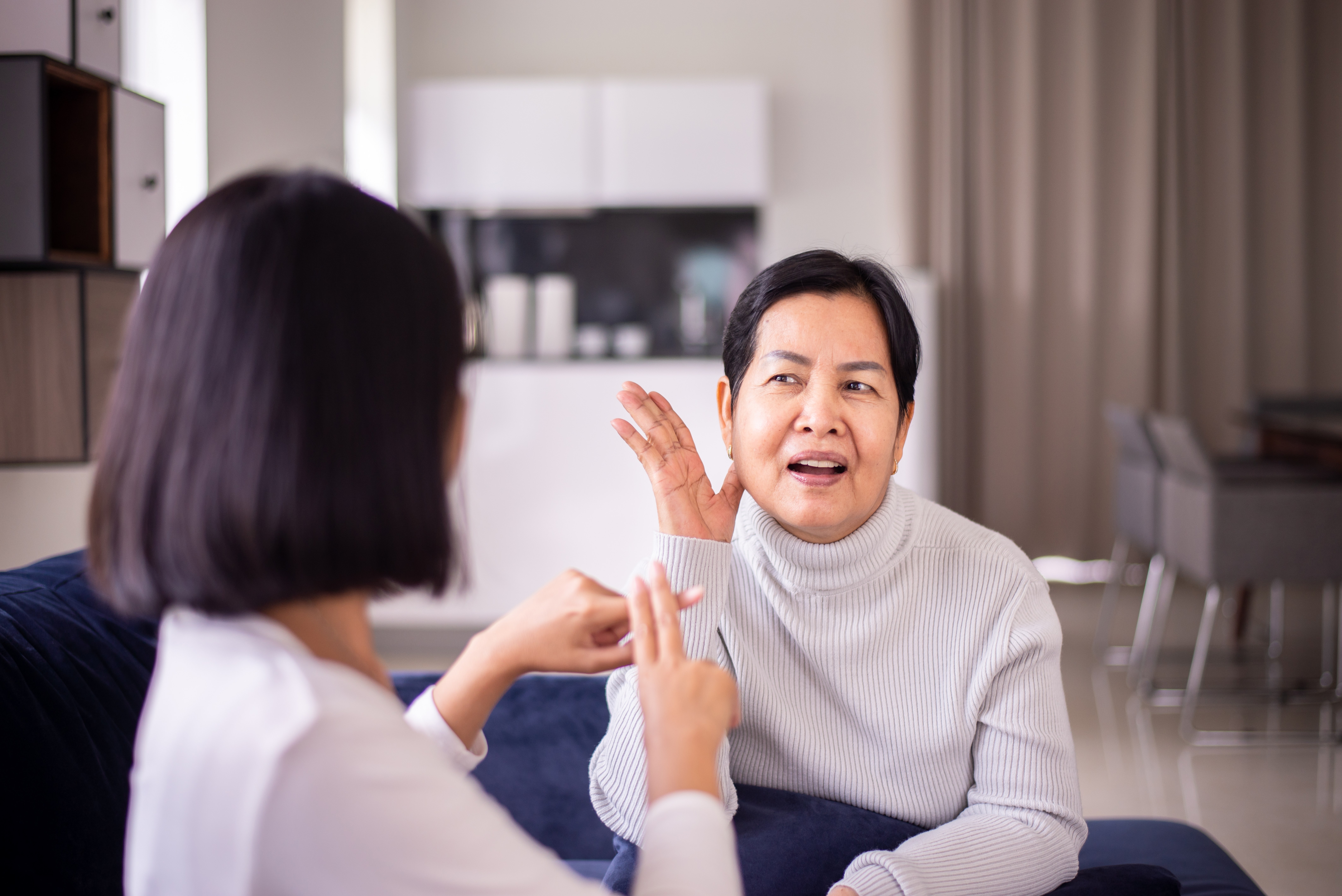 woman-using-sign-language-to-communiated-with-older-woman