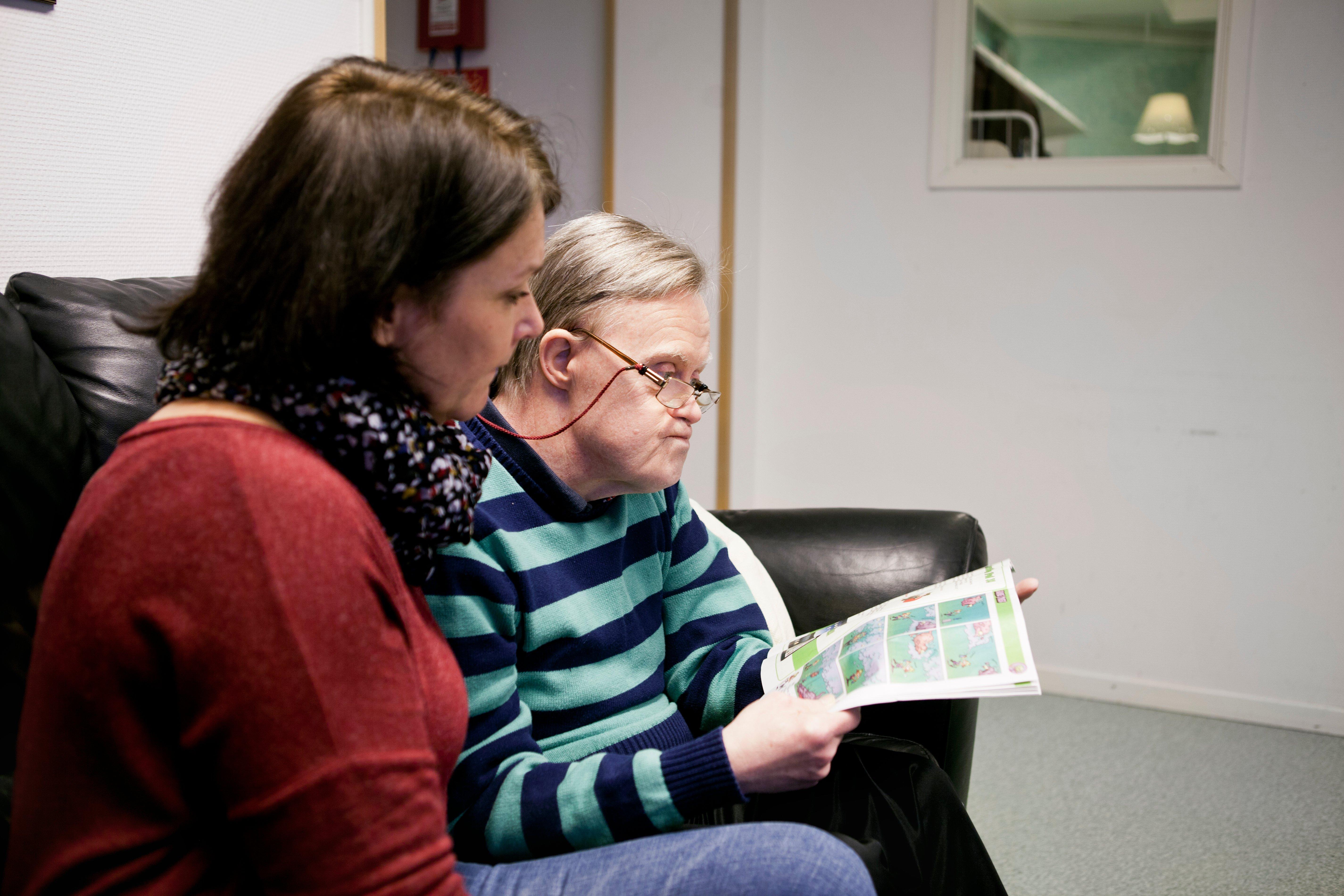caregiver-sitting-with-special-needs-senior-man