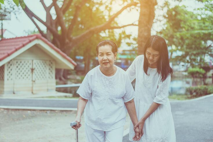 elderly-asian-female-walking-to-do-physical-with-stick-at-park-in-the-morning-daughter-take-care-and_t20_wlGrkK