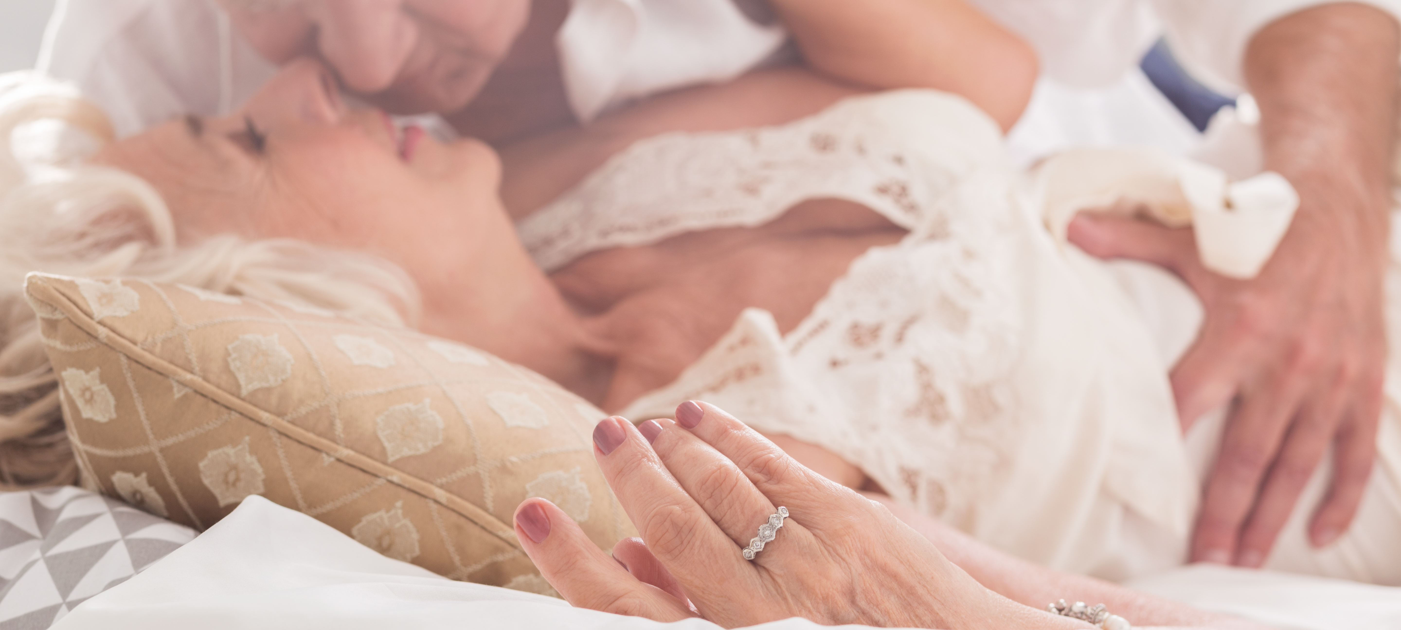 elderly-couple-kissing-in-bed