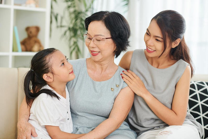 happy-asian-family-generation-at-home-RN364XQ