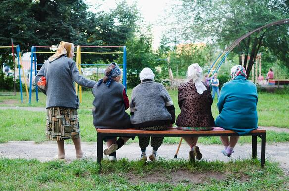 group-of-russian-woman-with-headscarves-sitting-on-bench