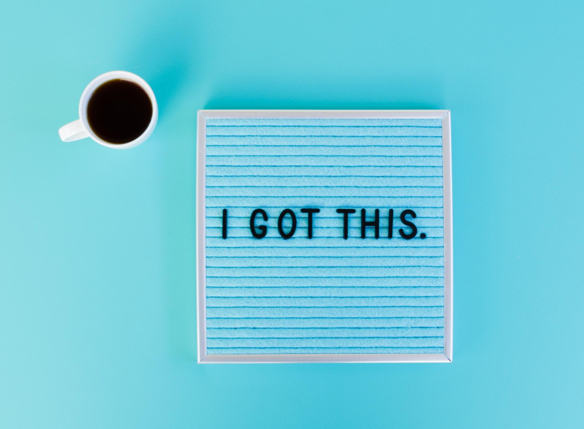 motivational-words-on-board-next-to-coffee-mug