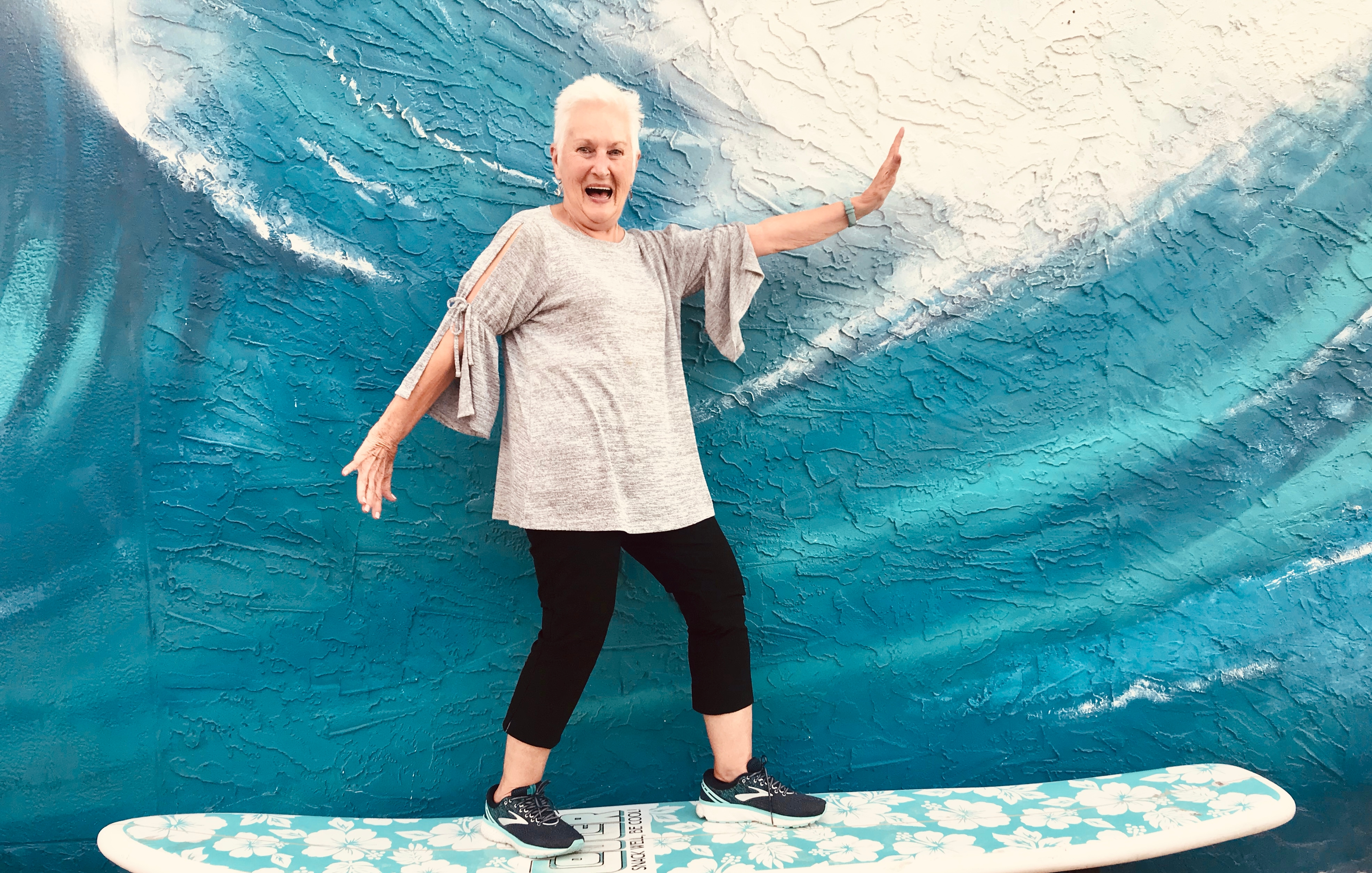 my-young-minded-active-adventurous-and-stylish-mother-grandmother-and-senior-surfing-on-a-surfboard_t20_GJj6me