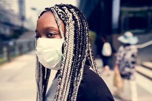 portrait-of-black-woman-wearing-mask-EARDNJG