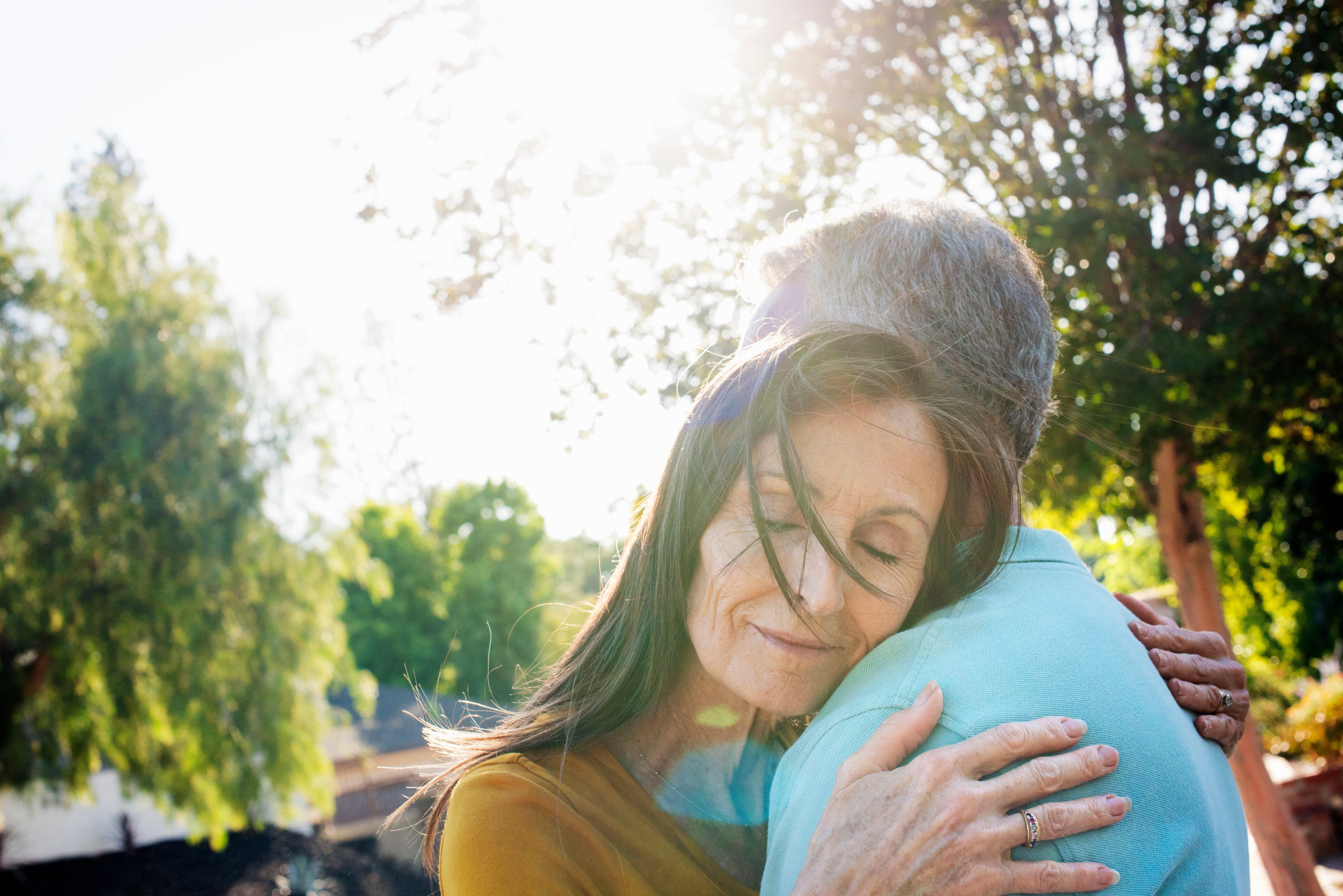 senior-couple-hugging-in-sunny-spot