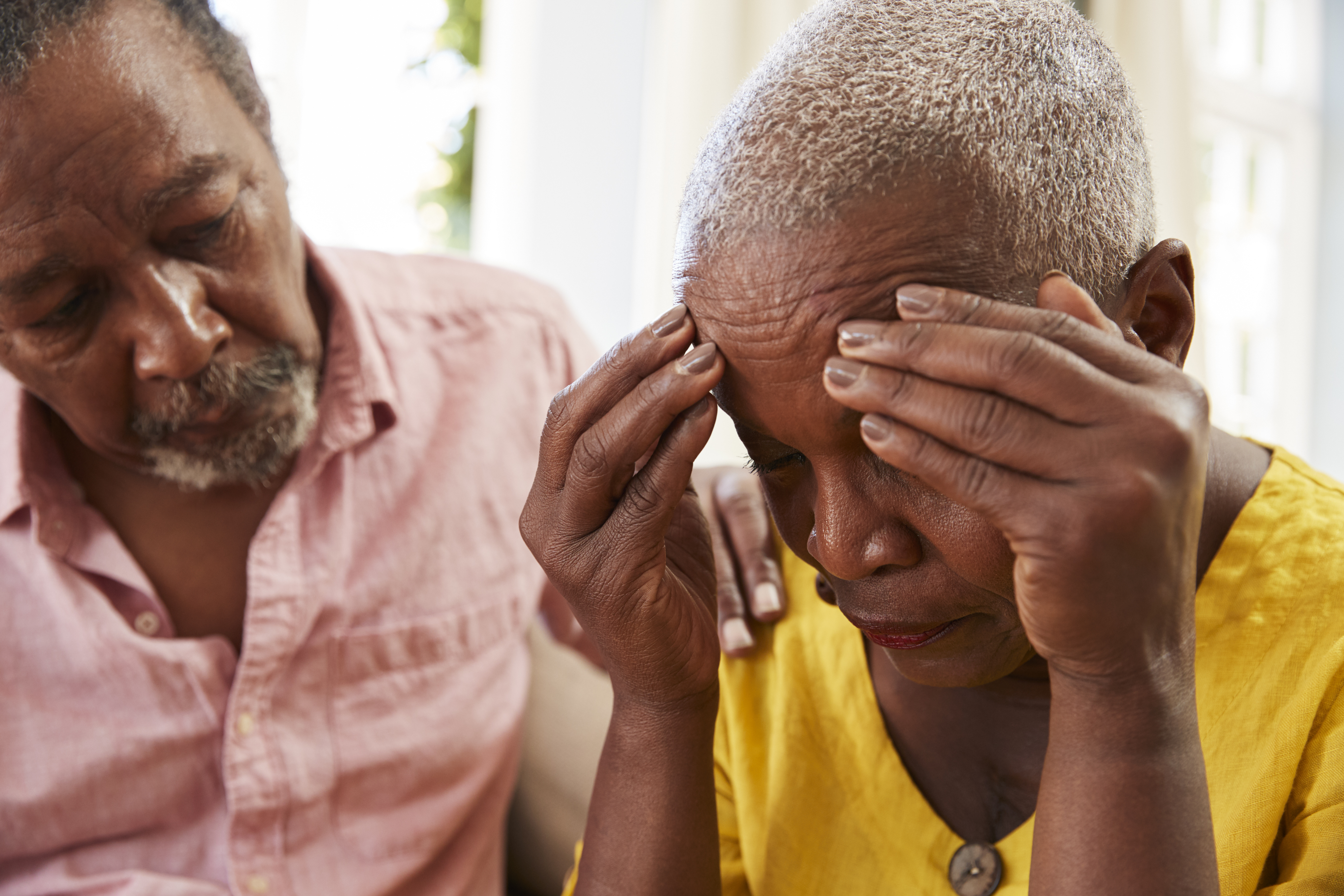 senior-man-comforting-woman-with-depression-at-home