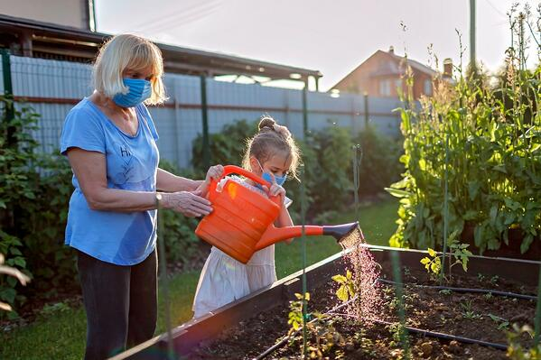 A girl waters plants with her grandma, an example of the freedoms you have with home care